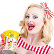Retro girl taking popcorn to cinema — Stock Photo