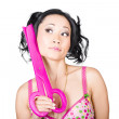 Young woman barber holding large pink scissors — Stock Photo