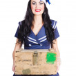 Sailor pin up holding nautical supplies — Stock Photo