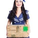 Sailor pin up holding nautical supplies — Stock Photo