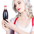 Stock Photo: Cute pin up girl with soda bottle. Vintage cafe
