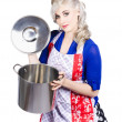 Young housewife lifting lid on a home cooking pot — Stok fotoğraf