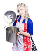 Young housewife lifting lid on a home cooking pot — Stock Photo