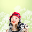 Woman taking photographs with vintage camera — Foto Stock