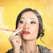 Beautiful reto lady smoking on yellow background — Stock Photo