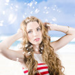 Beautiful girl wearing summer make-up on beach — Stock Photo #30082911