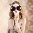 Beautiful surprised girl wearing big sunglasses — Stock Photo