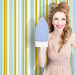 Happy retro housewife holding iron — Stock Photo #30083589