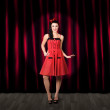 Stock Photo: Dancing womwearing retro rockabilly dress