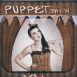 Vintage pinup girl inside a puppet show booth — Stock Photo