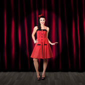 Dancing woman wearing retro rockabilly dress — Stock Photo