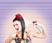 Pinup woman styling a hold with hair product — Stock Photo