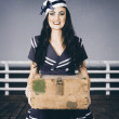 Stock Photo: Beautiful sailor girl holding military ammo box