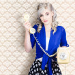 Retro portrait of a woman talking on vintage phone — Stock Photo