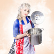 Beautiful young vintage housewife cooking up meal — Stock Photo