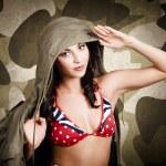 Sexy vintage army girl saluting — Stock Photo