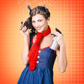 Beautiful woman using hair product to pin up hair — Stock Photo