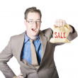 Shocked business man holding sale cash back bag — Stok fotoğraf