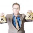 Stock Photo: Man holding money bags on white background