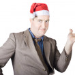 Christmas man showing copyspace gifts and presents — Stock Photo
