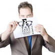 Mature Man Holding Glasses And Eye Checking Chart — Stock Photo