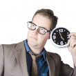 Businessman Holding Clock Near Ear — Stock Photo