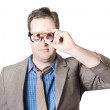 Stock Photo: BusinessmLooking Through Paper Binoculars