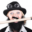 Foto Stock: Woman Wearing Bowler Hat Holding A Pencil In Mouth