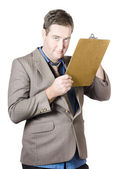 Businessman Holding Clipboard — Stock Photo