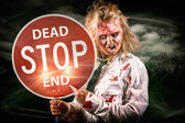 Halloween portrait. Scary zombie holding stop sign — Stock Photo