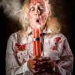 Stock Photo: Funny monster womwith bomb. Halloween countdown