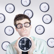 Time concept of a businessman holding quick clock — Stok fotoğraf