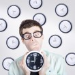 Stock Photo: Time concept of businessmholding quick clock