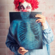 Scary clown peeking behind x-ray. Funny bones — Stock Photo