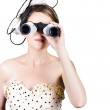 Retro woman looking through binoculars — Stock Photo