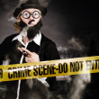 Sherlock Holmes detective at crime scene — Stock Photo #33312553