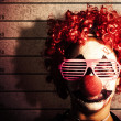 Clown criminal mug shot photo ID on police lines — Stock Photo