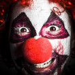 Scary and evil clown smiling in dark spooky style — Stock Photo