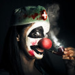 Fine art horror portrait. Smoking surgeon clown — Stock Photo