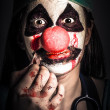 Horror clown girl in silence with stitched lips — Stock Photo #33317889