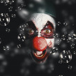 Scary horror circus clown laughing with evil smile — Stock Photo