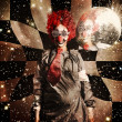 Stock Photo: Crazy dancing disco clown on a psychedelic trip