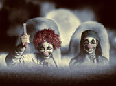 Evil zombie clown doctors rising from the dead — Stock Photo