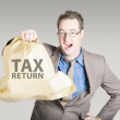 Accountant holding large tax return refund — Stock Photo