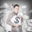 Stock Photo: Business person with money sack. Financial success