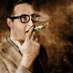 Vintage business man smoking money in success — Stock Photo #38651025