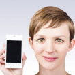 Woman holding phone in hand with empty screen — Stockfoto