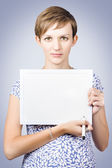 Serious woman holding white board with marker pen — Stock Photo