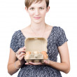 Stock Photo: Pregnant young womdisplaying box of eggs