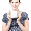 Stock Photo: Young pregnant womholding carton of eggs